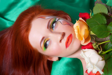 Portrait of beautiful red-haired girl with flowers