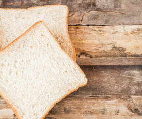 slice bread on wooden background