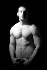 Portrait of shirtless handsome man in black and white