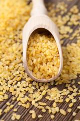Vegan healthy bulghur dieting nutrition wheat grain in spoon on