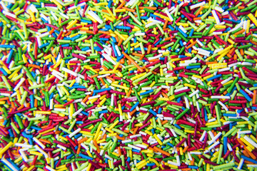 Mix of colorful Sugar sticks powder background
