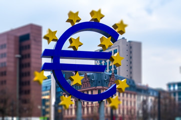 Euro sign at Franfurt. Blurred defocused photo