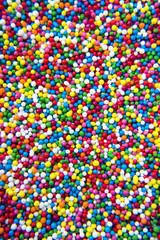 Mix of colorful Sugar balls powder background