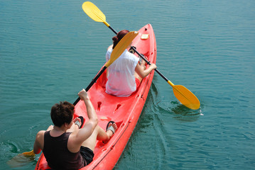 Travelar paddle a kayak on the sea. Kayaking on island