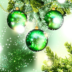 Christmas background with green baubles on a branch