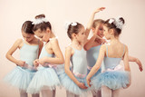 Group of five little ballerinas preparing for performance