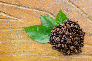 Coffee beans with leaves top view
