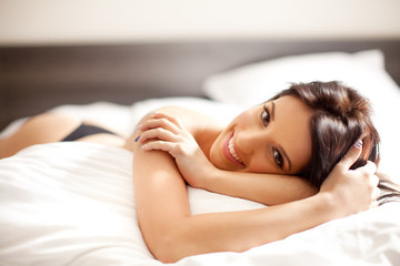 Beautiful woman in the bed