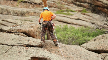 Man Trains to Conquer the Rock, Rock Climber Format