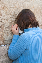 Woman prays at the Wailing Wall, Jerusalem Israel