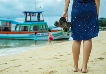 woman walks along the seashore