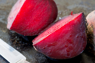 Two slices baked beets in a pan