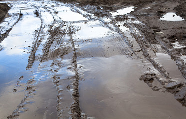 Mud and puddles on the dirt road