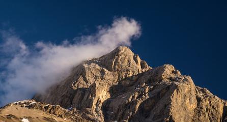 High mountain peak during sunrise. Natural landscape