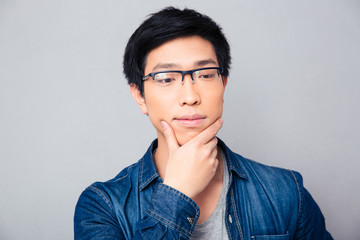 Portrait of a thoughtful asian man
