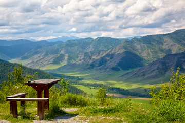 Wooden table and bench on the top of mountain pass Chike-Taman i