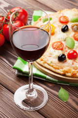 Glass of red wine and italian pizza
