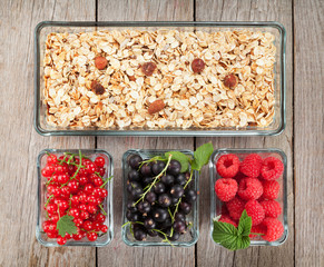 Healthy breakfast with muesli and berries
