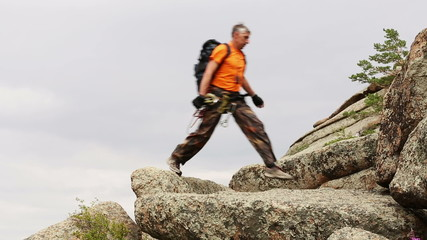 Male hiker in mountains, rear view