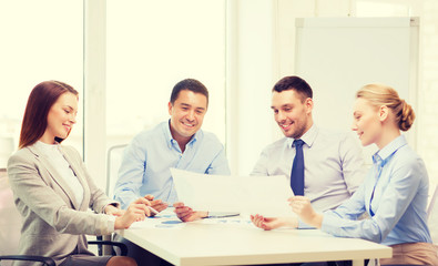 smiling business team having discussion in office