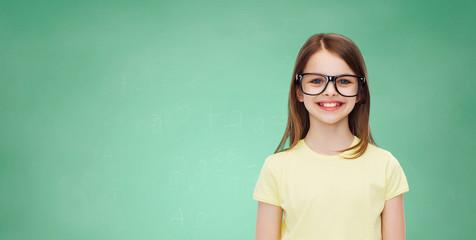 smiling cute little girl in black eyeglasses