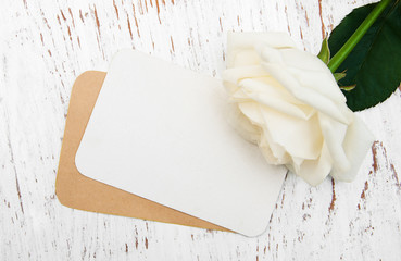 White rose with card