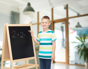 happy little boy with blackboard and chalk