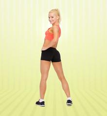 athletic woman in sportswear from back