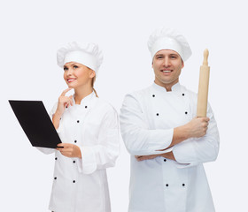 happy male chef cook holding rolling pin