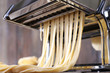 Making noodles with pasta machine, closeup - 82114449