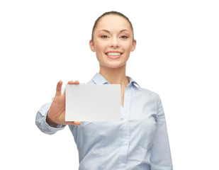 smiling businesswoman showing white blank card
