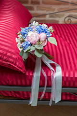 bridal bouquet on a sofa