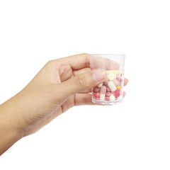 hand holdind Colorful tablets with capsules and pills on white b