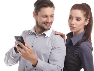 Attractive couple taking a selfie together on white background