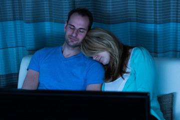 Couple Sleeping In Front Of Television