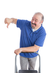 Man Leaning Against a Chair in Thumbs Down Sign