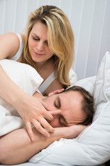 Woman Is Holding Husband's Nose