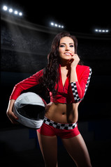 Girl racer with helmet at stadium