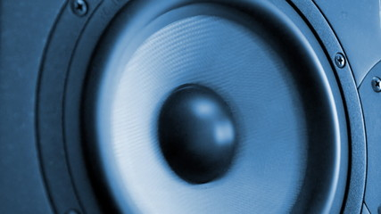 Moving professional music studio monitor. Close-up.