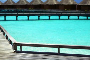 Water villas over ocean background