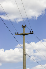 Concreet electrical pole with power lines