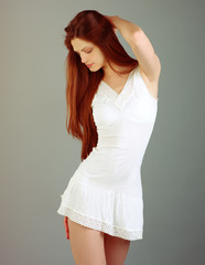 Young beautiful female model in white dress
