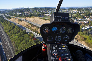 Helicopter In Flight Over Freeway