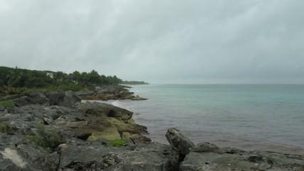 Rainy weather on rocky Caribbean beach in Tulum, Mexico