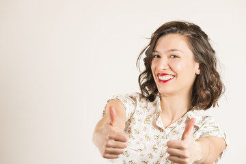 Portrait of attractive young woman show thumbs up gesture