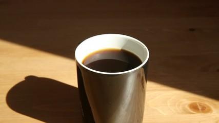 A hot coffee mug steaming lightly