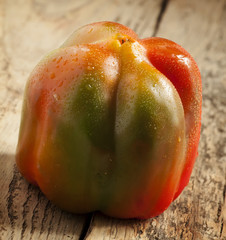 bell pepper with water drops on a wooden table