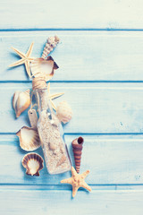 Marine items on blue painted wooden background.