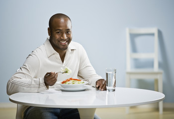 African man eating dinner