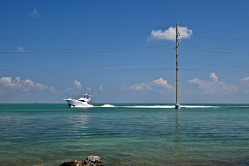 Boat Driving Past a Utility Pole